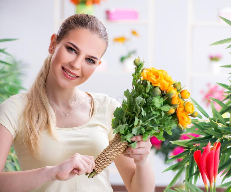 Young woman watering plants in her garden royalty free stock photos