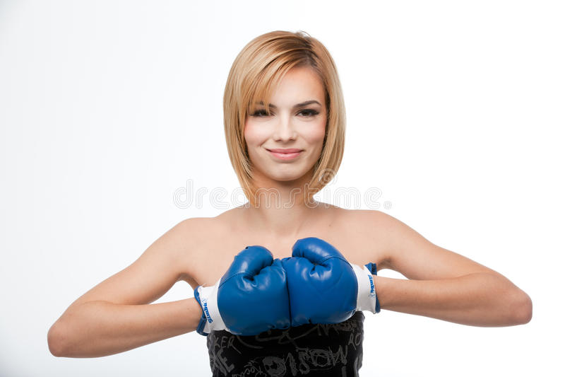 Young woman wearing boxing gloves and smiling stock photo
