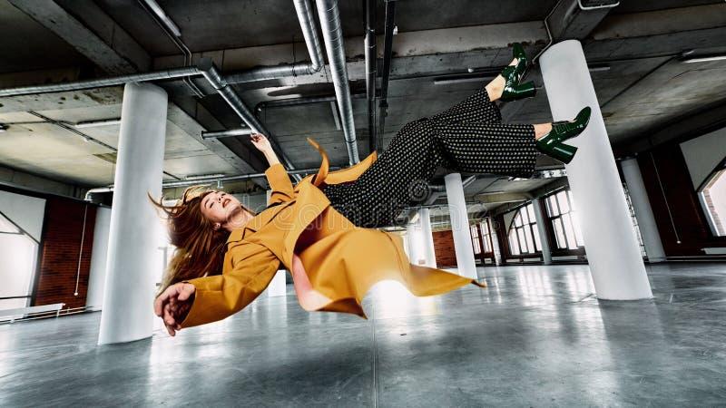 Beautiful female in zero gravity stock photo