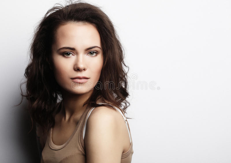 Young woman wearing casual clothes, posing on white background royalty free stock photo