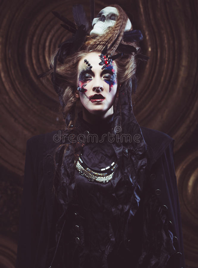 Young woman wearing dark costume. Bright make up and smoke- halloween theme. Young beautifull woman wearing dark costume. Bright make up and smoke- halloween stock photos