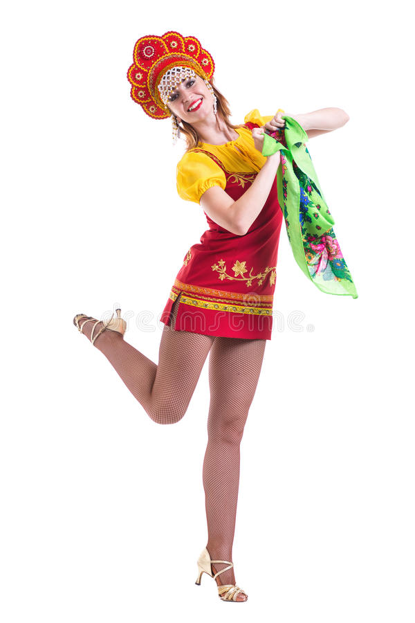 Young woman wearing a folk costumes dancing. Isolated on white in full length with copyspace stock image