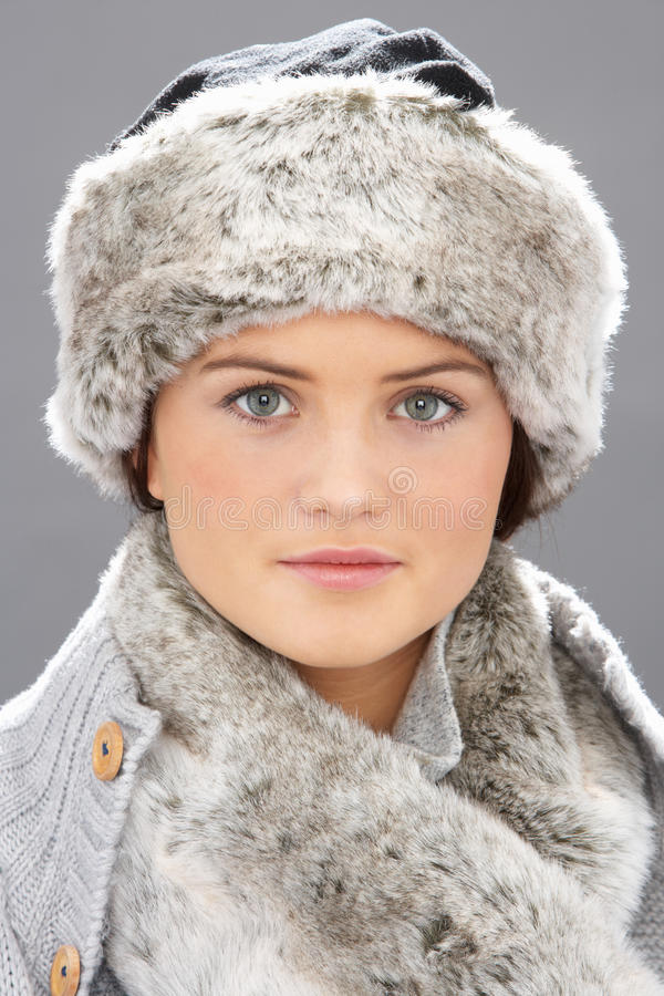 Young Woman Wearing Fur Hat And Wrap Stock Photography