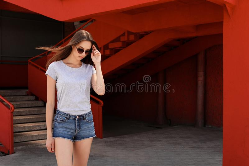 Young woman wearing gray t-shirt on street royalty free stock photo