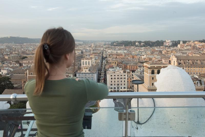 Woman on roof in Rome royalty free stock photo