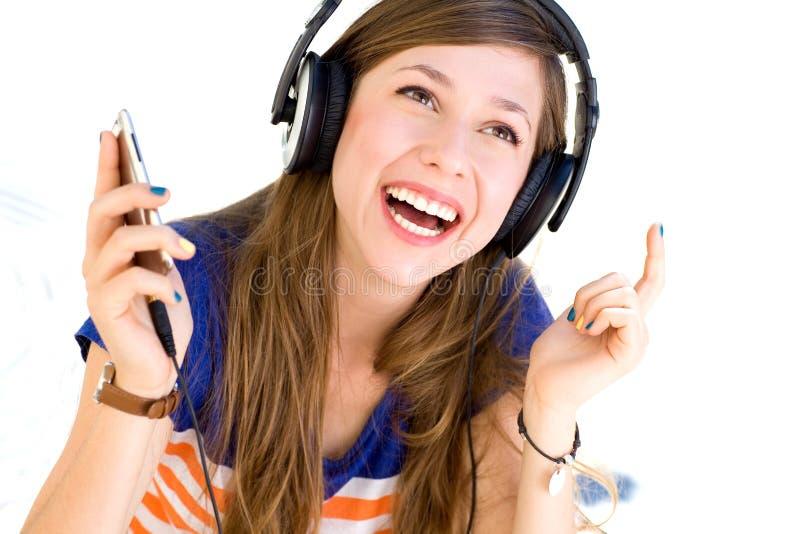 Download Young Woman Wearing Headphones Stock Photo - Image of teenage, joyful: 21262446