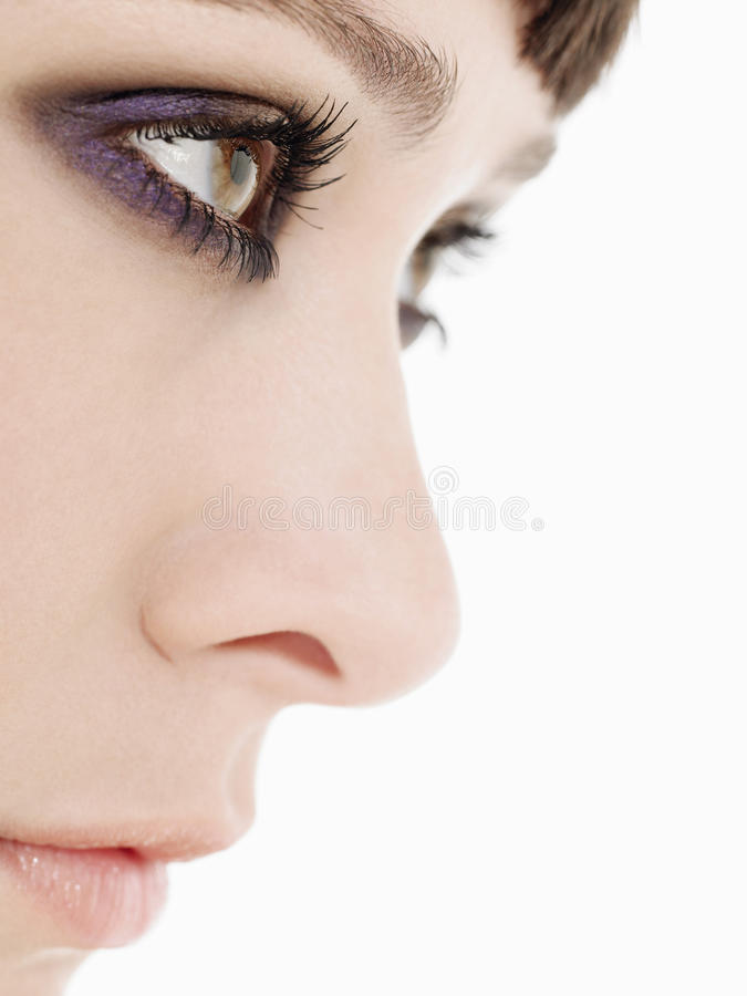 Young Woman Wearing Heavy Eye Makeup Side View Close Up ...