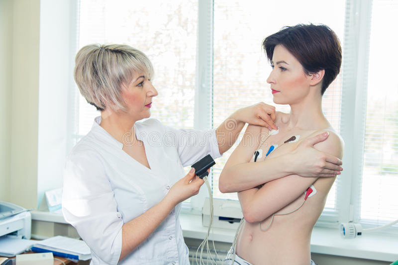 Young woman wearing a Holter Heart Monitor stock photo