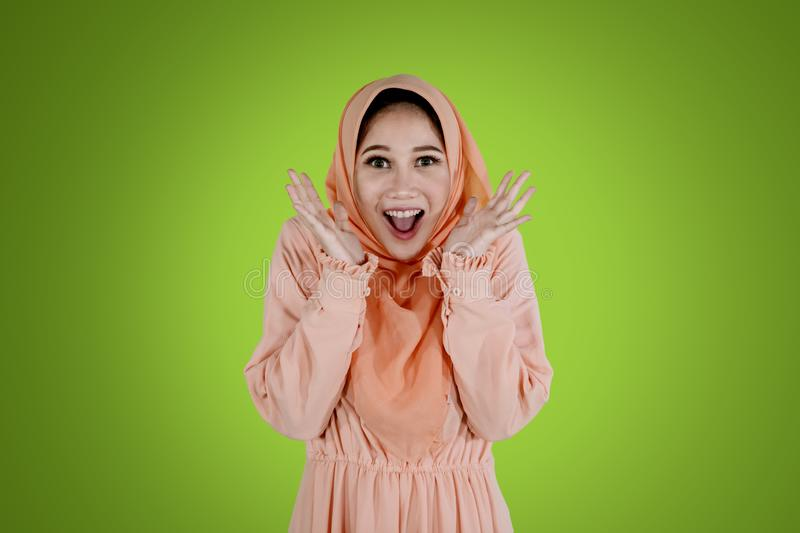 Muslim woman stands with shocked expression stock photo