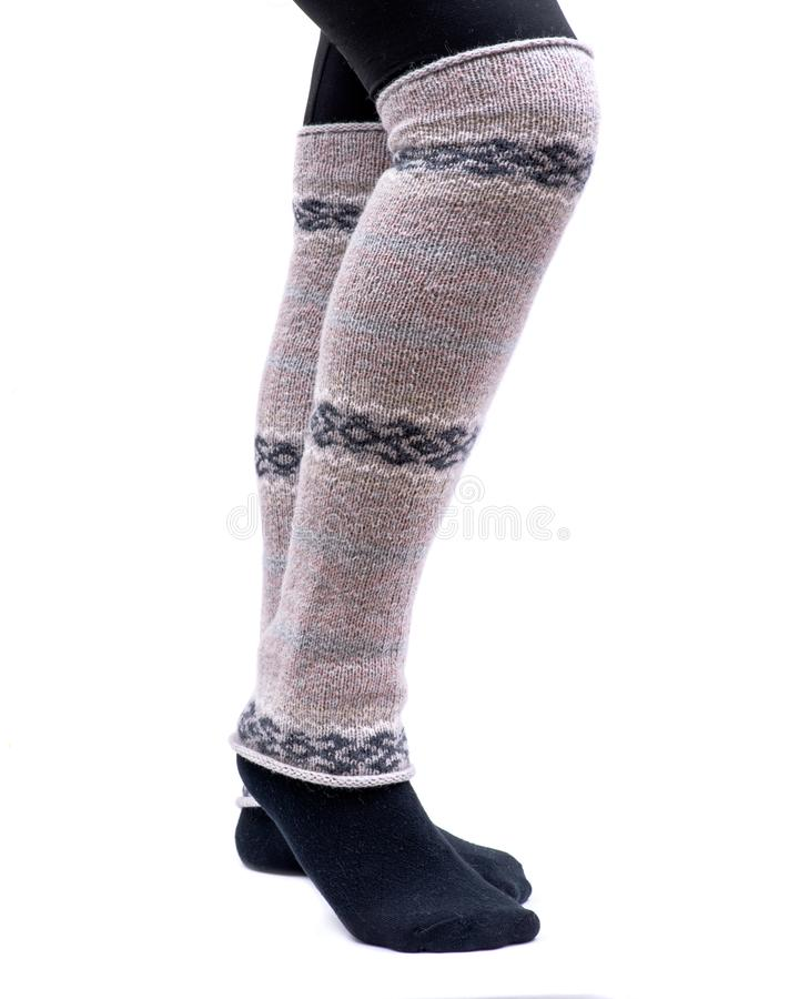 Young woman wearing lemon Fair Isle leg warmers isolated on white royalty free stock image