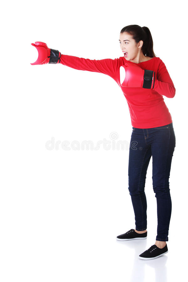 Young woman wearing a pair of boxing gloves. Woman ready for fight with problems concept royalty free stock photography