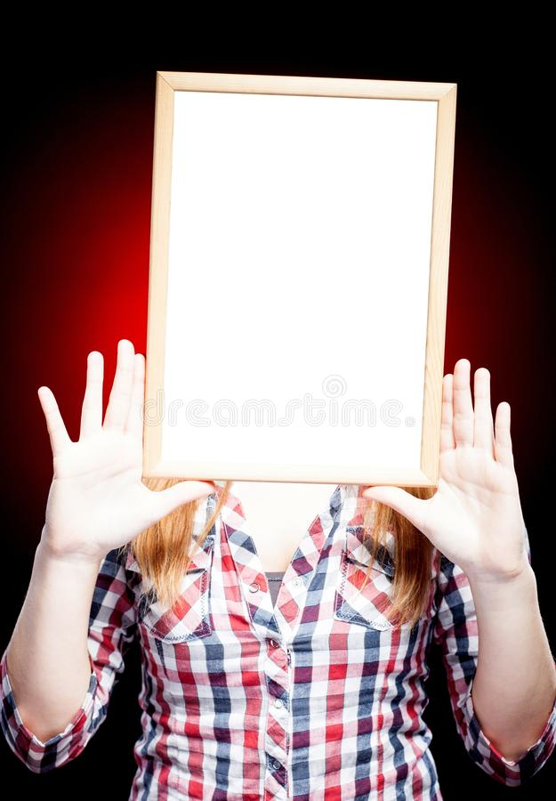 Young woman wearing plaid shirt holding empty frame royalty free stock photos