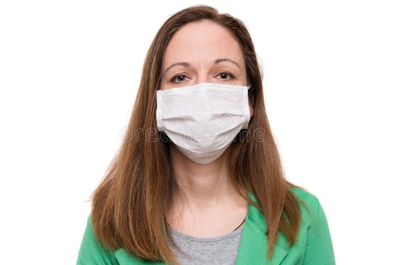 Young woman wearing protection face mask against coronavirus royalty free stock photo