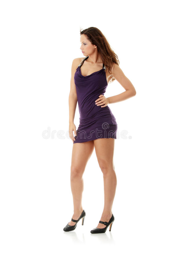 Young woman wearing a purple dress stock image