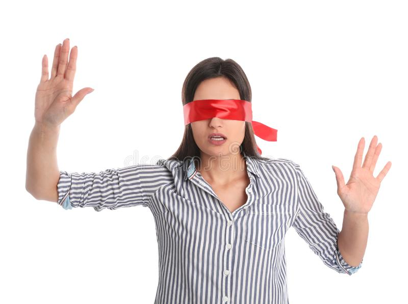 Young woman wearing red blindfold on white royalty free stock photos