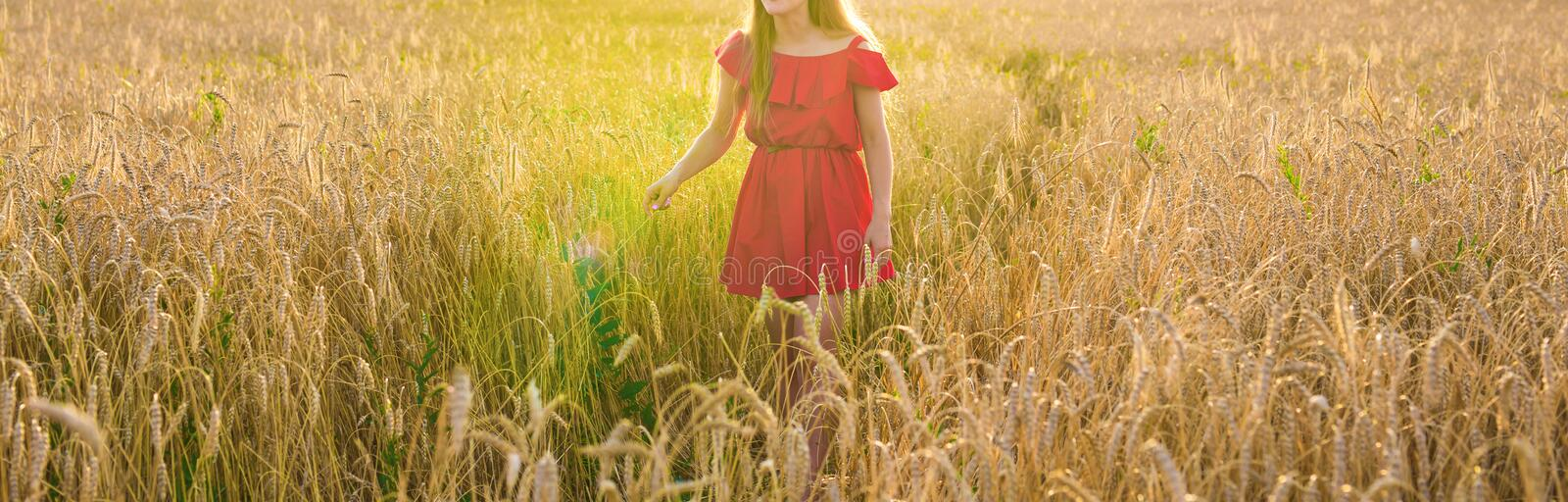 Young Woman wearing red dress at Summer Field closeup stock photos
