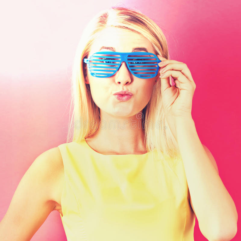 Young woman wearing shutter shades sunglasses royalty free stock photos