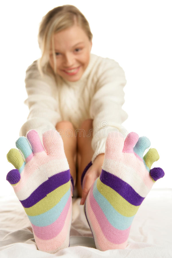 Young woman wearing socks royalty free stock photography