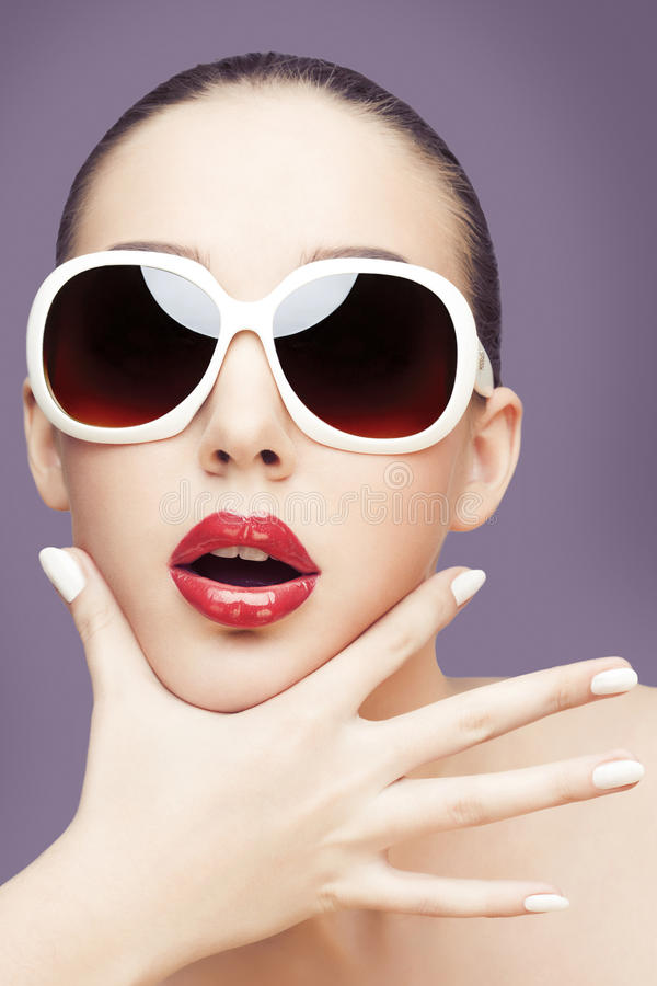 Young woman wearing sunglasses royalty free stock image