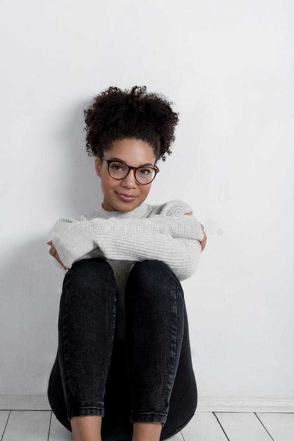 Young woman wearing sweater stock photos