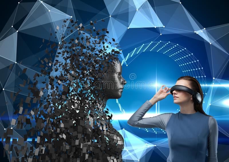 Young woman wearing VR headphones and looking at 3d scattered female figure stock photos