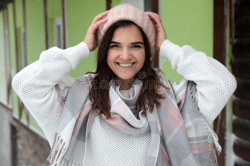 Young woman wearing warm sweater and scarf outdoors on day. Winter season. Young woman wearing warm sweater and scarf  outdoors on snowy day. Winter season royalty free stock photos