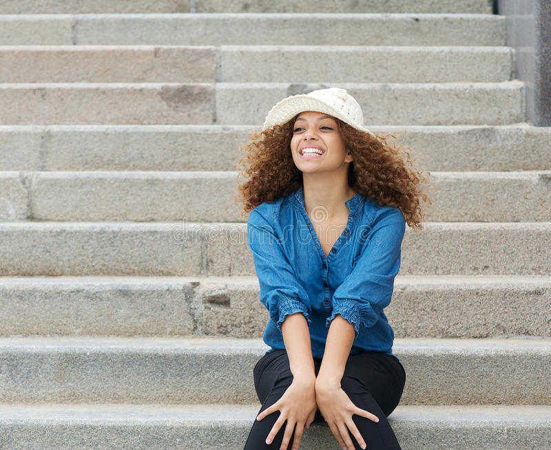 Download Young Woman Wearing White Hat And Sitting On Stairs Stock Image - Image: 34391613
