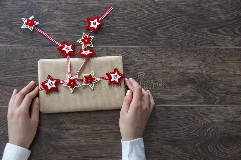 Young woman wearing white jumper holding Christmas gift box royalty free stock images