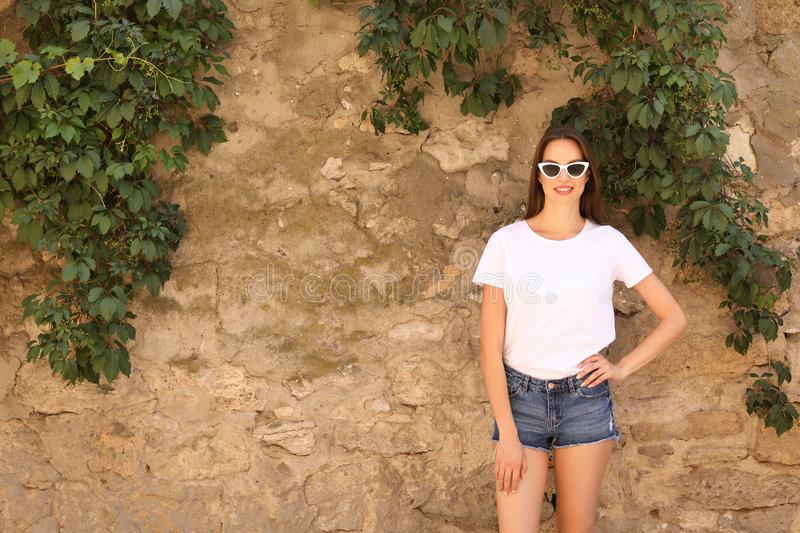 Young woman wearing white t-shirt royalty free stock photography