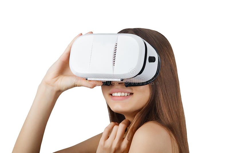 Young woman wearing white virtual reality glasses isolated stock photography