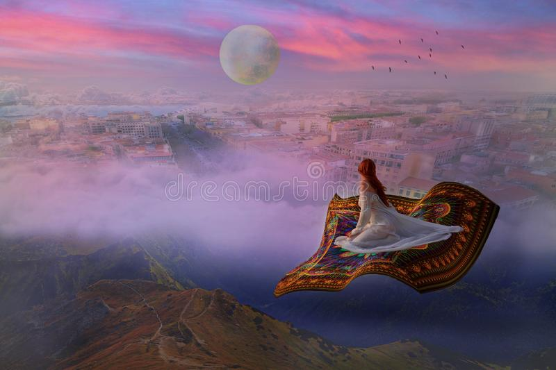 Bride flying on a carpet above clouds and city royalty free stock image