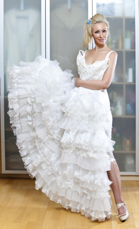The young woman with a wedding dress in hands dreams about wedding royalty free stock photography