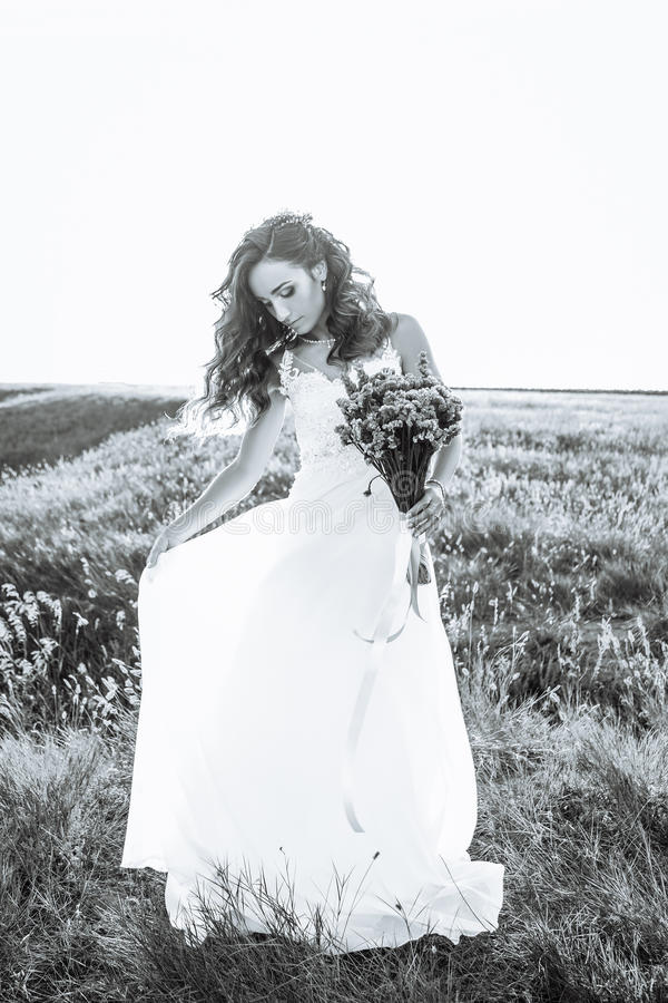 Young woman in wedding dress outdoors royalty free stock photo