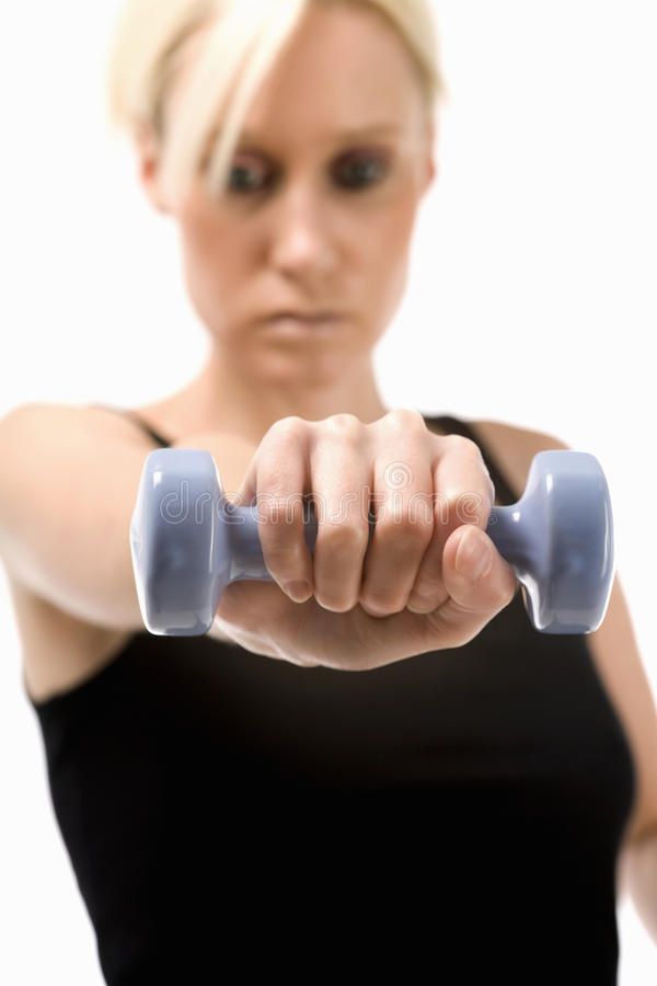 Young woman with weights royalty free stock images