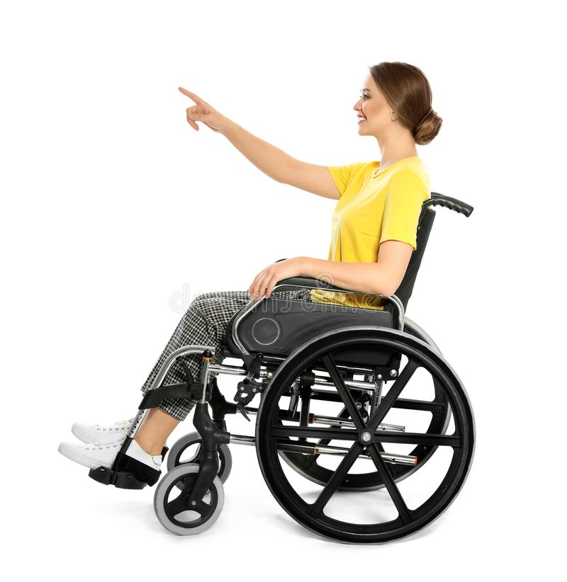 Young woman in wheelchair pointing on something royalty free stock images