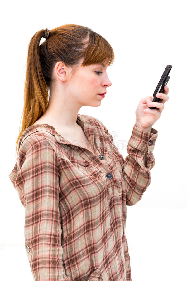 Young woman which read by phone royalty free stock photography