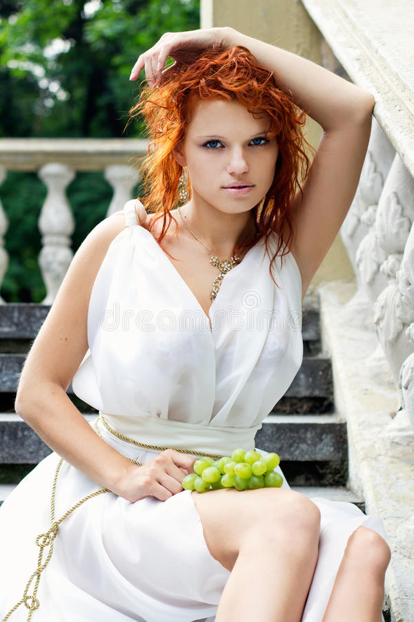 Young woman in white antique dress stock photo