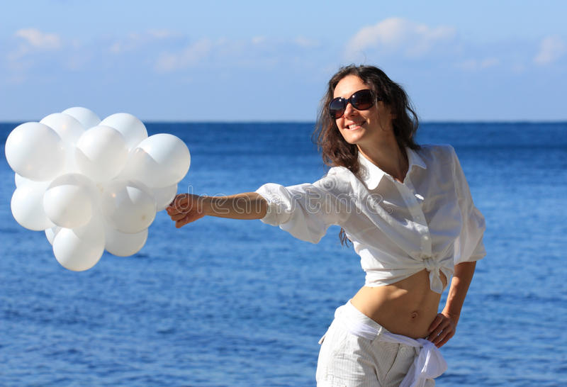 Download Young Woman With White Balloons Stock Photo - Image: 16832400