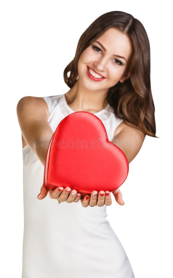 Young woman in white dress holds heart shaped box. stock photos