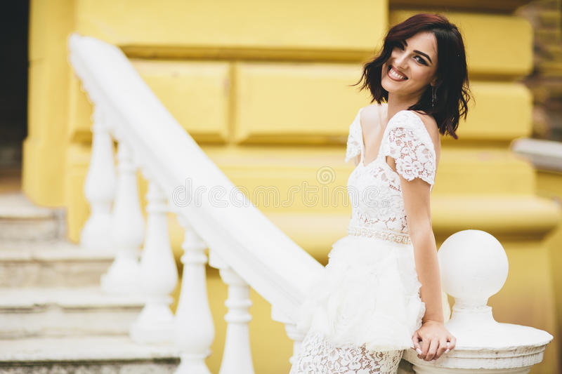 Young woman in white dress on the street stock image