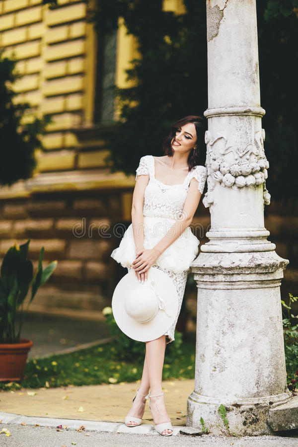 Young woman in white dress on the street royalty free stock photo