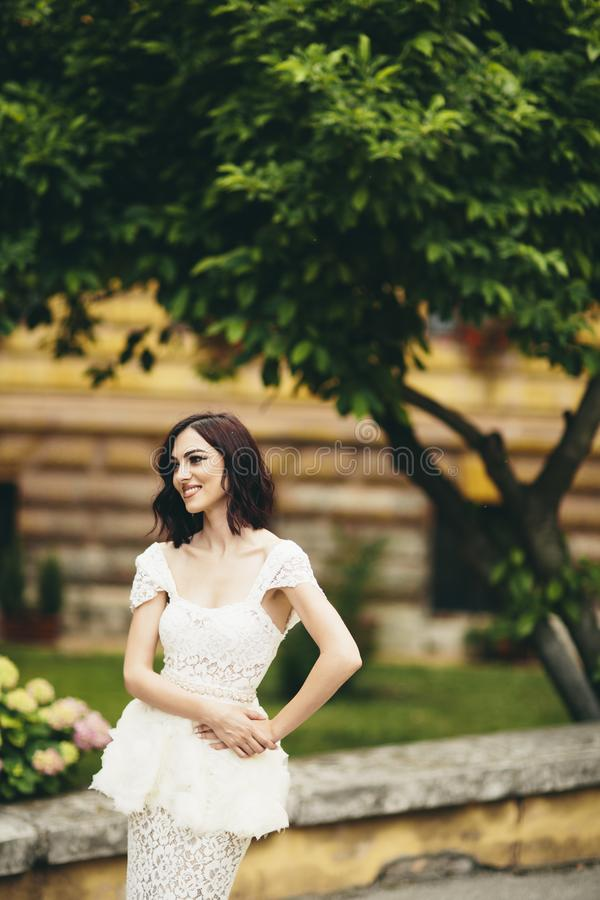 Young woman in white dress on the street stock photography