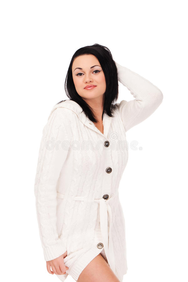 Young woman in white knitted dressing gown. On isolated white background royalty free stock images
