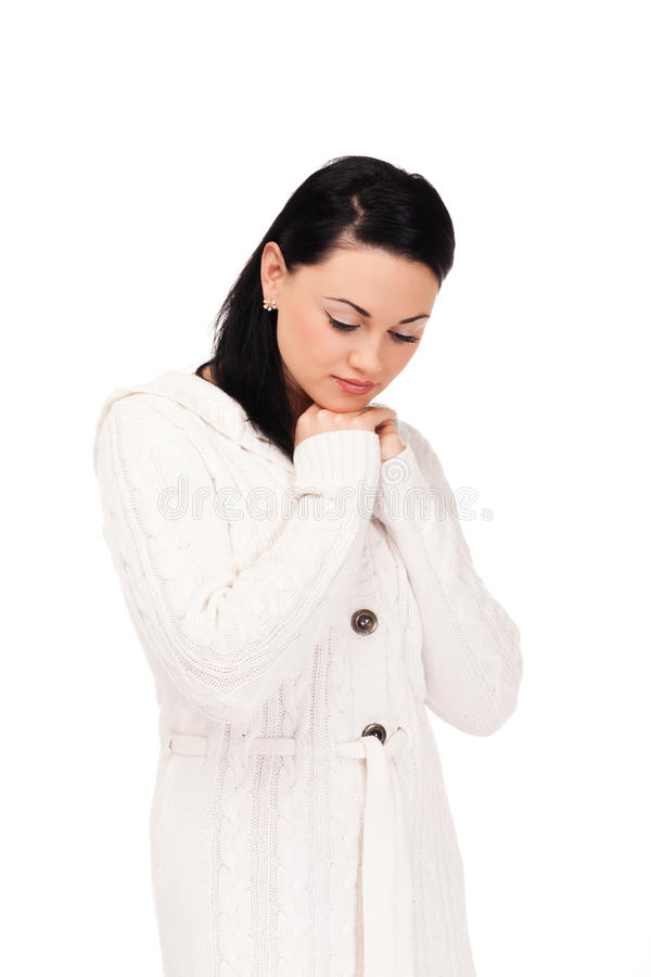 Young woman in white knitted dressing gown. On isolated white background royalty free stock photography