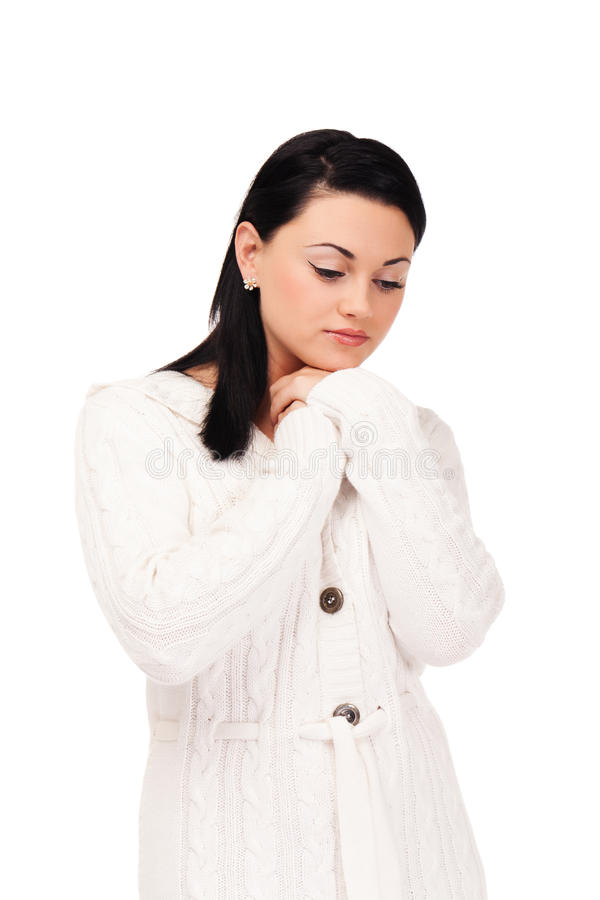 Young woman in white knitted dressing gown. On isolated white background stock image