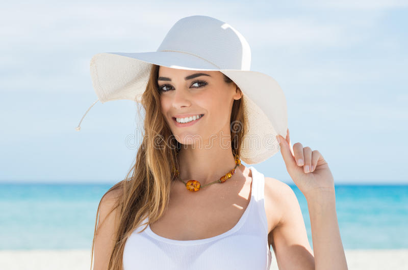 Young Woman In White Sun Hat Relaxing On Beach stock image