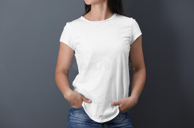 Young woman in white t-shirt on color background royalty free stock image