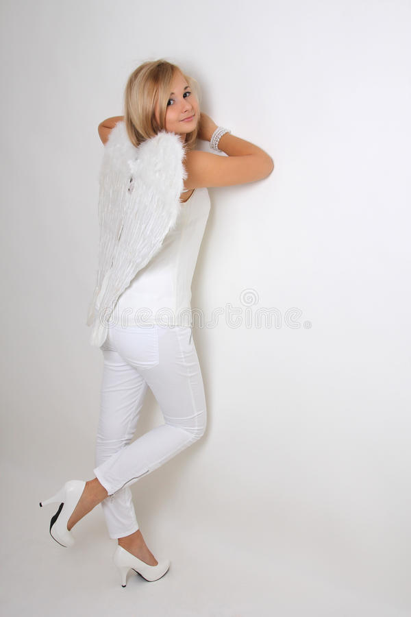 Young woman with white wings royalty free stock photo