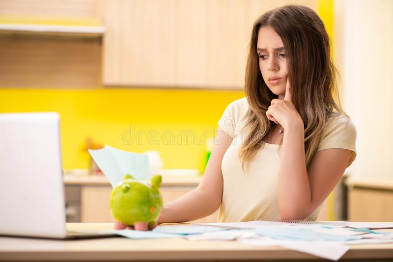 The young woman wife in budget planning concept stock photo