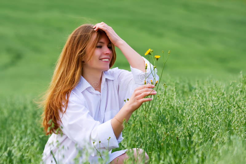 Young woman and wild flowers. royalty free stock photography
